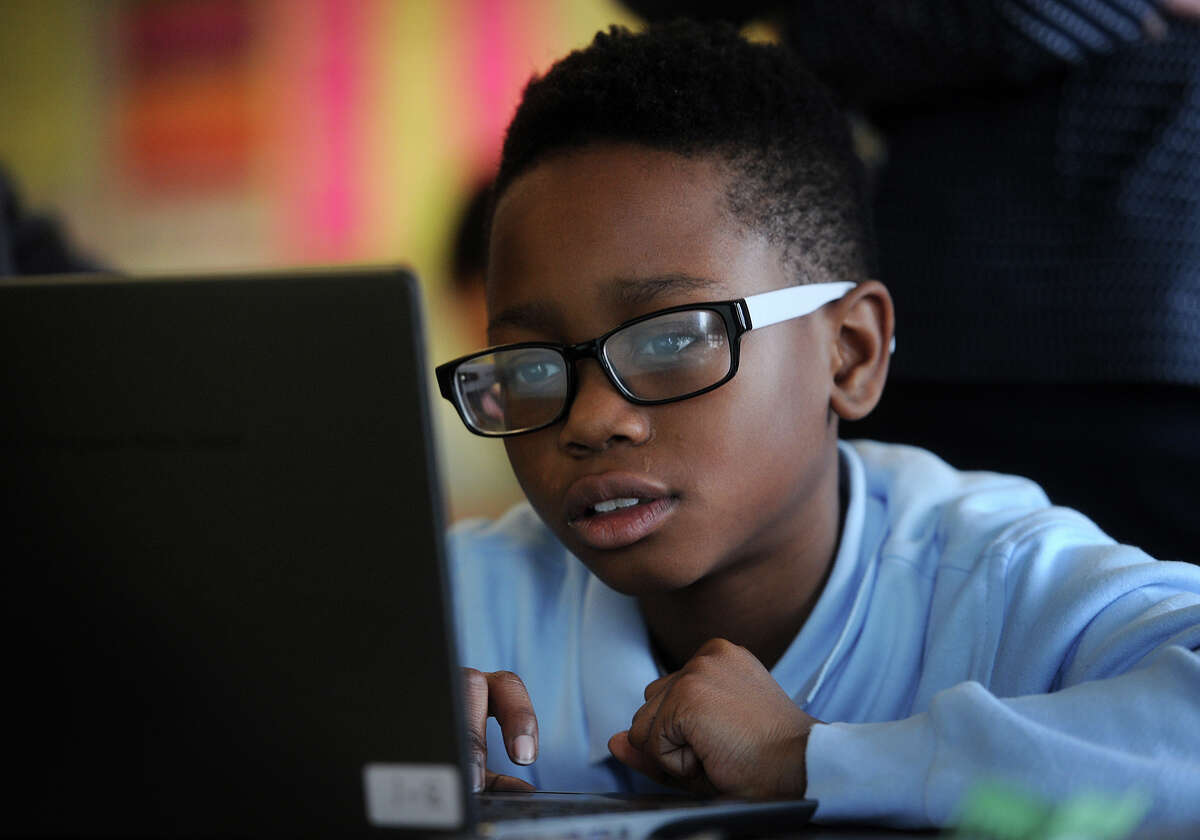 Sixth grader Isreal Burton, 11, familiarizes himself with the format of the new common core standardized test, which will be taken online, at Jettie Tisdale School in Bridgeport, Conn. on Tuesday, March 10, 2015.