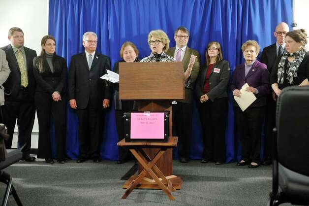 Barbara Bartoletti, League of Women Voters legislative director, surrounded by legislators, and representatives from civic groups, labor organizations and public education advocates, voices her opposition to the education investment tax credit in Governor Cuomo's budget, during a press conference on Monday, March 9, 2015, in Albany, N.Y.  (Paul Buckowski / Times Union) Photo: PAUL BUCKOWSKI, Albany Times Union / 00030939A