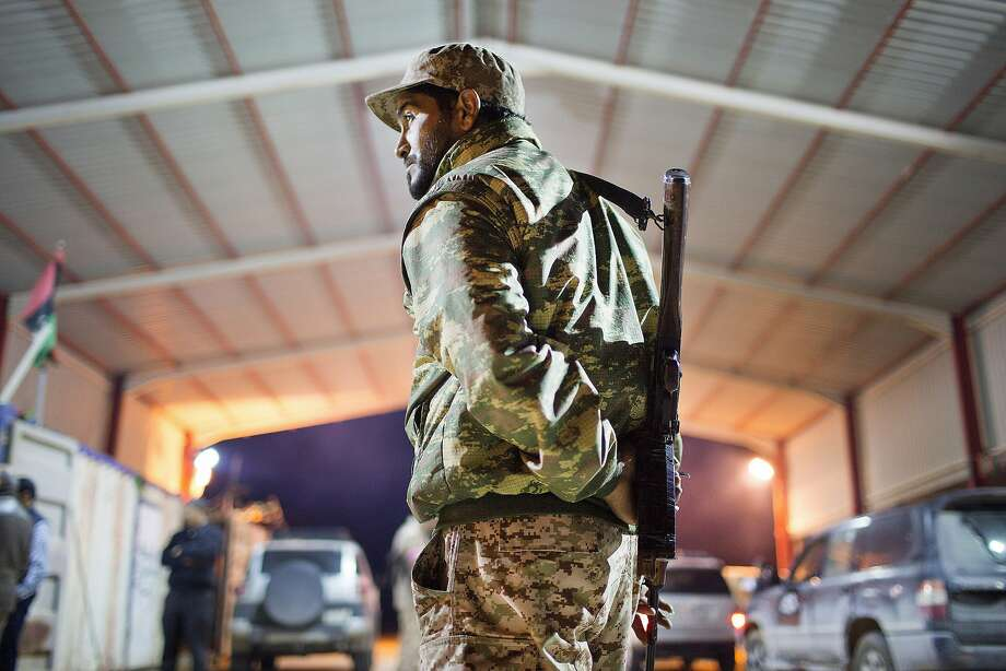 A Libyan military soldier stands guard at the entrance of a town, 68 miles from Sirte. Photo: Mohamed Ben Khalifa, Associated Press