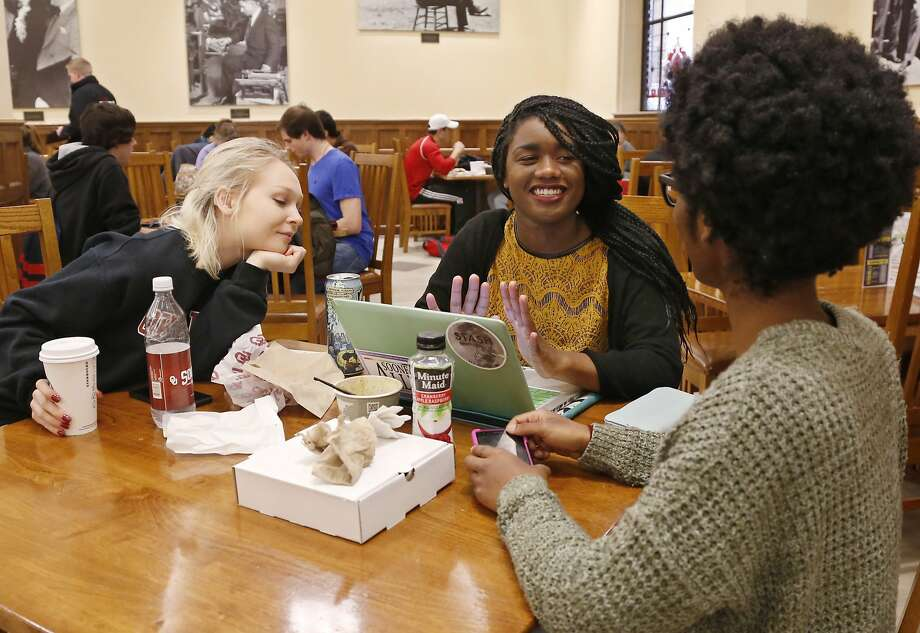 Sophomores Stephanie Logan (left) of McCloud, Okla., Latrecia Breath of Newalla, Okla., and Shawntal Brown of Oklahoma City stop for lunch at the student union at the University of Oklahoma, in Norman. Breath said the recent video from the Sigma Alpha Epsilon fraternity was hurtful and damaging to people's identity and self. Photo: Sue Ogrocki, Associated Press