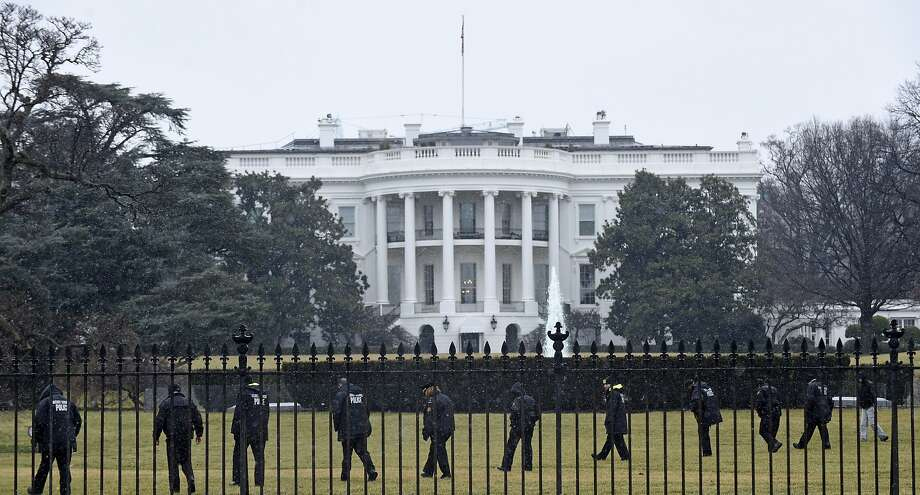 Secret Service officers search the White House grounds in January after a wayward quadcopter drone landed on the lawn. Photo: Susan Walsh, Associated Press