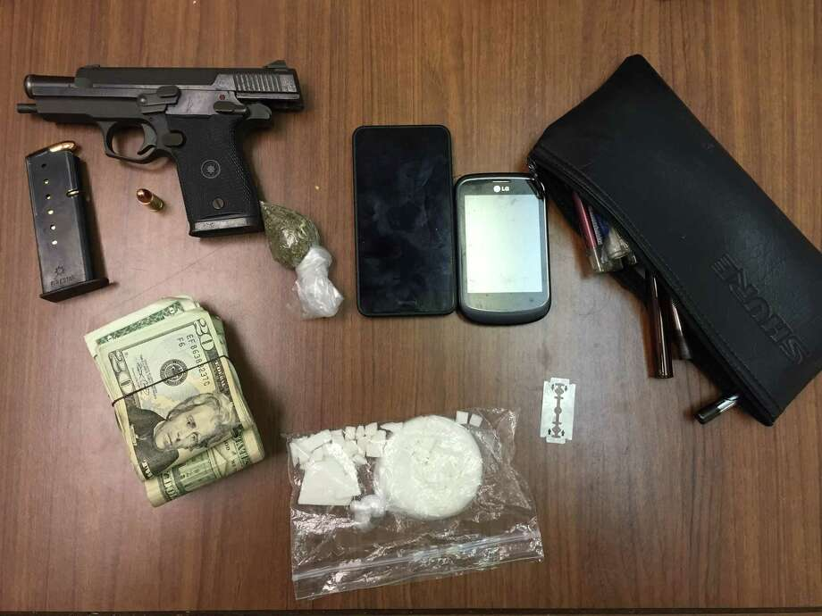 A large amount of crack cocaine, marijuana, a 9 mm handgun and approximately $2,500 were retrieved by Fayette County Sheriff's Office Narcotics Unit.  Photo: Daniel Pérez