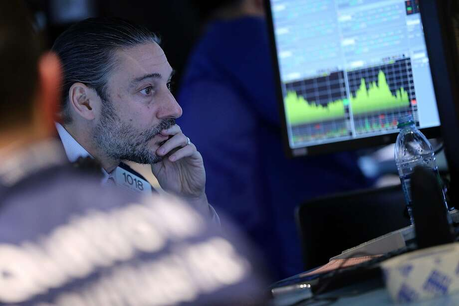 Traders watch stocks plummet as investors are worried aobut a possible increase in interest rates. Photo: Spencer Platt, Getty Images