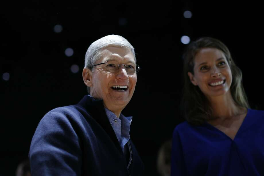 SAN FRANCISCO, CA - MARCH 9: Apple CEO Tim Cook and model Christy Turlington Burns smiles as they appear at the Apple Watch demonstration area during an Apple special event at the Yerba Buena Center for the Arts on March 9, 2015 in San Francisco, California. Apple Inc. is expected to unveil more details on the much anticipated Apple Watch, the tech giant's entry into the rapidly growing wearable technology segment. (Photo by Stephen Lam/Getty Images) Photo: Stephen Lam, Getty Images