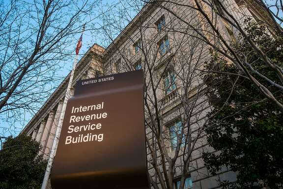 FILE- In this April 13, 2014 file photo, the Internal Revenue Service Headquarters (IRS) building is seen in Washington. The rich aren't taxed enough and the middle-class is taxed too much. As for your taxes, you probably think they're too high as well. Those are the results of a new Associated Press-GfK poll, which found that most Americans support President Barack Obama's proposal to raise investment taxes on high-income families. The findings echo the populist messages of Sens. Elizabeth Warren and Bernie Sanders, two liberals being courted by the progressive wing of the Democratic Party to run for president in 2016. The findings also add weight to Obama's new push to raise taxes on the rich and use some of the revenue to lower taxes on the middle class.  (AP Photo/J. David Ake, File)