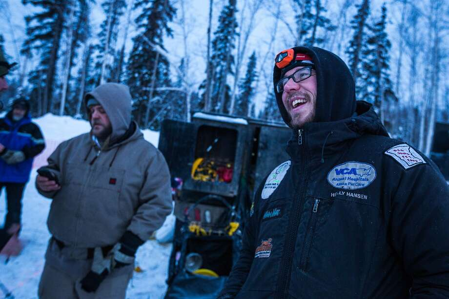 Musher Brent Sass, right, relaxes after arriving in Fairbanks for the start of the Iditarod Trail Sled Dog Race, Monday, March 9, 2015, in Fairbanks, Alaska. Iditarod mushers began their 1,000-mile trek across Alaska along a new route Monday after poor trail conditions forced organizers to push the race's start north, bypassing a mountain range. (AP Photo/Alaska Dispatch News, Loren Holmes) Photo: Loren Holmes, Associated Press