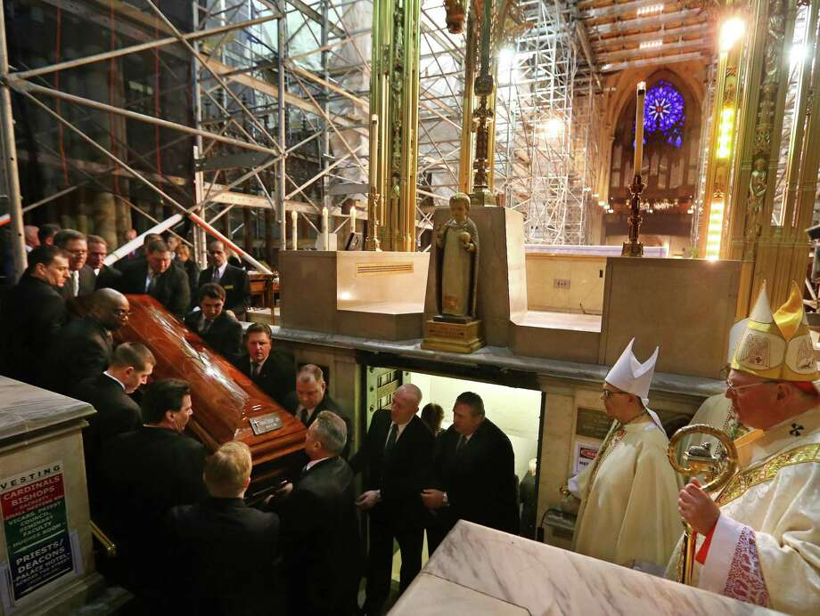 Cardinal Timothy M. Dolan, right, leads the entombment of the late Cardinal Edward Egan, as Egan's casket it carried to the crypt beneath the altar of St. Patrick's Cathedral in New York following the funeral Mass for Egan, Tuesday, March 10, 2015. Egan, who led the New York Archdiocese for nearly a decade, died March 5, 2015 at age at 82. Photo: Chang W. Lee, New York Times, Chang W. Lee, Pool / Associated Press