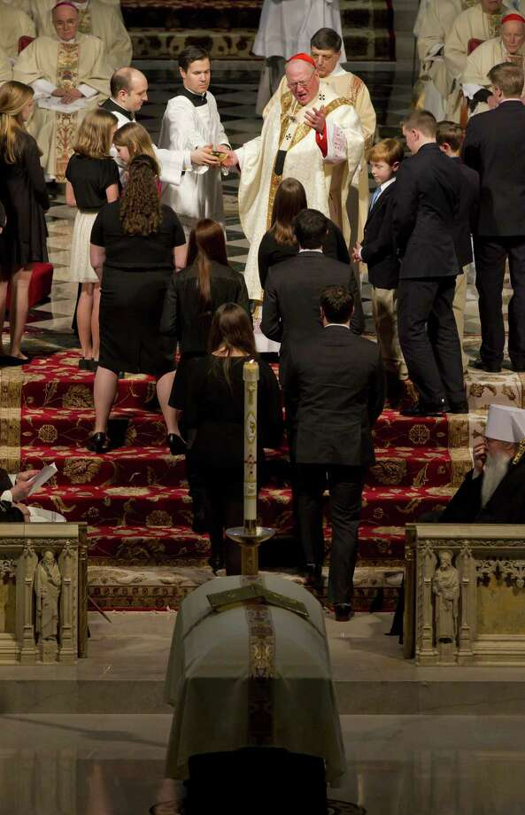Cardinal Timothy Dolan greets members of the Egan family at St. Patrick's Cathedral during a funeral mass March 10, 2015 in New York City. Egan, who led the New York Archdiocese for nearly a decade died March 5, at age 82. Photo: Pool, Chad Rachman-Pool/Getty Images / 2015 Getty Images