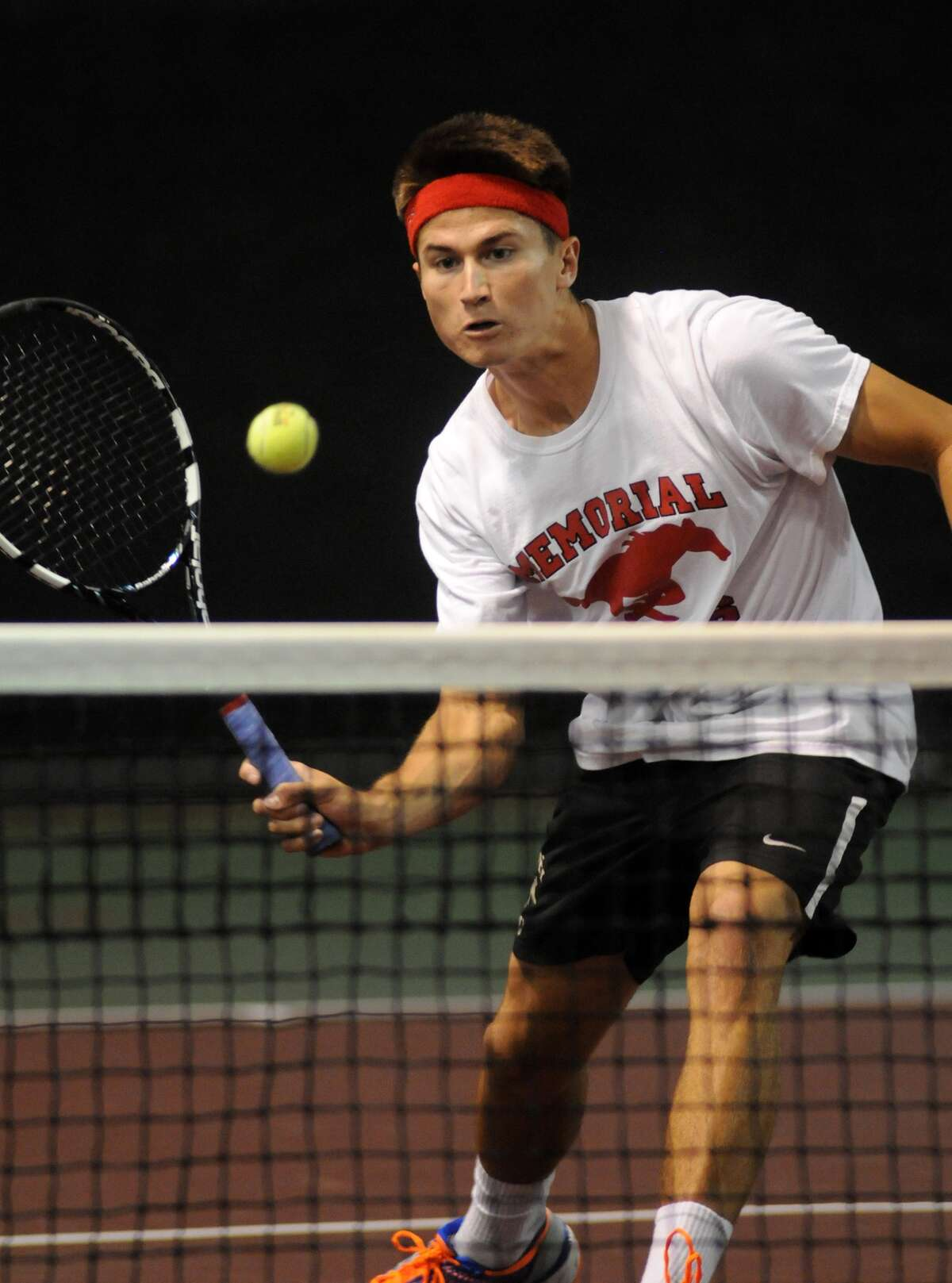 Memorial's Dane Esses, above, and Tadhg Collins, below, will compete for the Mustangs at the UIL Class 6A Tennis Tournament at Texas A&M May 12 and 13.