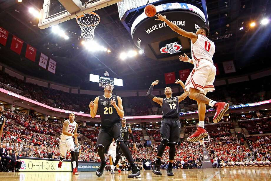 Ohio State's D'Angelo Russell (left) gets 19.2 points, 5.6 rebounds and 5.2 assists per game. Photo: Kirk Irwin, Getty Images