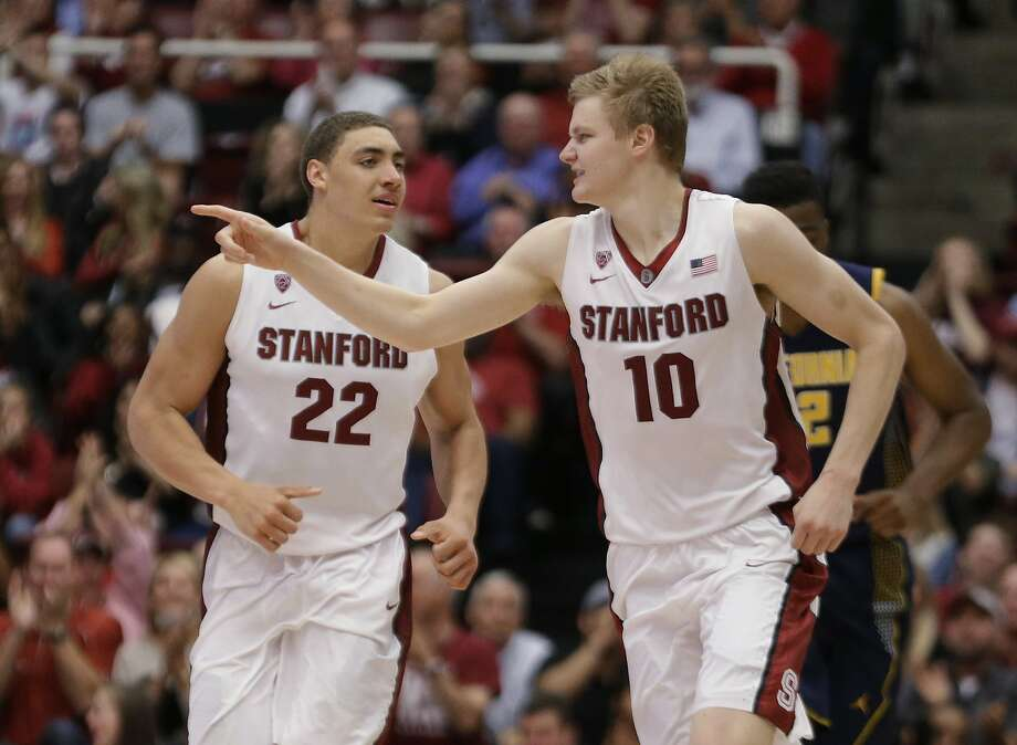 Stanford forward Michael Humphrey, right, points to a teammate after scoring against California, next to teammate Reid Travis during the second half of an NCAA college basketball game Saturday, Feb. 21, 2015, in Stanford, Calif. Stanford won 72-61. (AP Photo/Eric Risberg) Photo: Eric Risberg, Associated Press