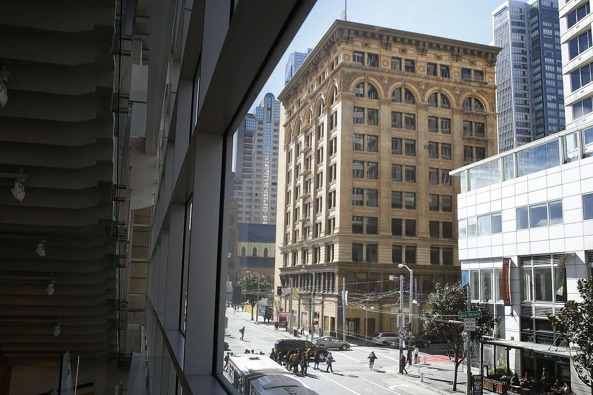 Millennium Partners is breaking ground on a new condo tower and Mexican Museum next to the Rochester Big & Tall Building (creme building seen on corner) in San Francisco, California on Friday, February 27, 2015.