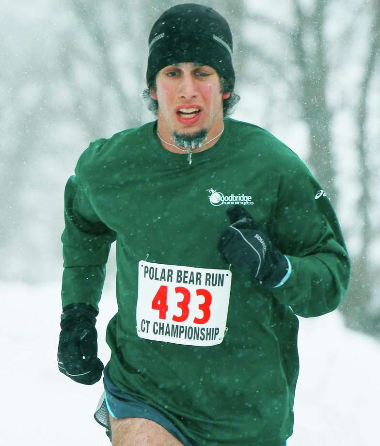 Taylor Phillips, 24,  of Brookfield pays no heed to an icicle forming on his goatee en route to a runnerup finish in the 31st edition of the Polar Bear road race around Lake Waramaug in Washington on March 1, 2015.  Courtesy of Randy O'Rourke/Big Play Photos Photo: Contributed Photo / The News-Times Contributed