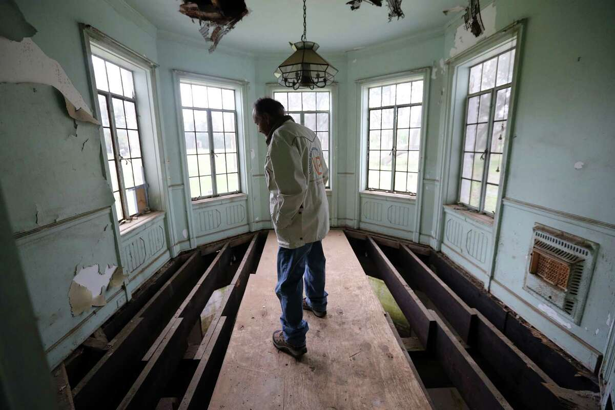 Darryl Schroeder walks through the cleared-out mansion on South MacGregor Way in Riverside Terrace.