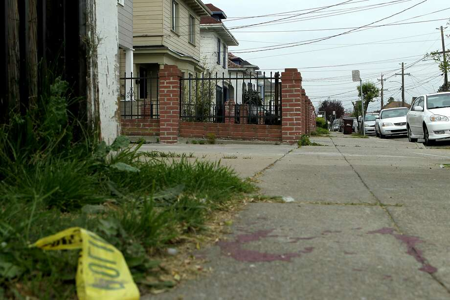 Crime tape is seen near the home of Chyemil Pierce on Tuesday, March 10, 2015, in Oakland, Calif. Pierce, 30, a Kaiser employee, was slain and two other people were wounded when a gun battle erupted on the 2800 block of Chestnut Street. Photo: Santiago Mejia, The Chronicle