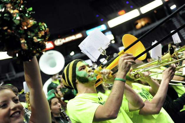 Siena pep band trombonist Adam Nelson, center, shows his school spirit during their first round game against Niagara in the MAAC Championship on Thursday, March 5, 2015, at Times Union Center in Albany, N.Y. (Cindy Schultz / Times Union) Photo: Cindy Schultz / 10030857A
