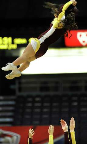 An Iona cheerleader gets tossed in the air during their quarterfinal game against Siena in the MAAC Championship on Friday, March 6, 2015, at Times Union Center in Albany, N.Y. (Cindy Schultz / Times Union) Photo: Cindy Schultz / 10030865A
