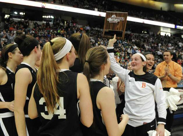 Bethlehem's Kaylee Rickert holds up the championship plaque following Bethlehem's 55-46 win over Shenendehowa in the Section II Class AA Girls' Basketball Final at the Times Union Center on Tuesday March 10, 2015 in Albany, N.Y. (Michael P. Farrell/Times Union) Photo: Michael P. Farrell / 00030948A