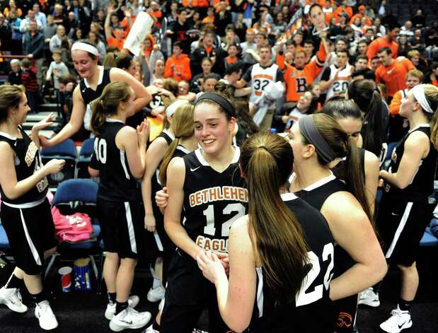 Bethlehem's Jenna Giacon, center, and her teammates celebrate their 55-46 win over Shenendehowa in the Section II Class AA Girls' Basketball Final at the Times Union Center in Albany, N.Y.  (Michael P. Farrell/Times Union) Photo: Michael P. Farrell / 00030948A