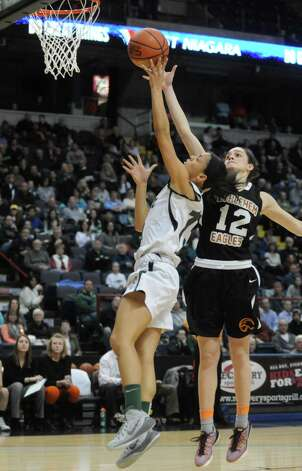 Bethlehem's  Jenna Giacone defends a shot from Shen's Sydney Brown during Bethlehem's 55-46 win over Shenendehowa in the Section II Class AA Girls' Basketball Final at the Times Union Center on Tuesday March 10, 2015 in Albany, N.Y. (Michael P. Farrell/Times Union) Photo: Michael P. Farrell / 00030948A