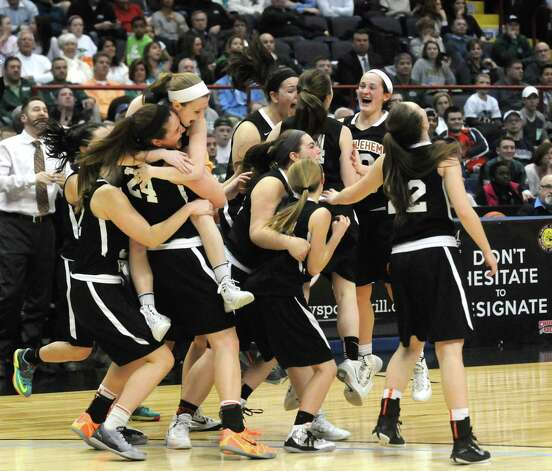 Bethlehem High School teammates celebrate their 55-46 win over Shenendehowa in the Section II Class AA Girls' Basketball Final at the Times Union Center in Albany, N.Y.  (Michael P. Farrell/Times Union) Photo: Michael P. Farrell, Albany Times Union / 00030948A