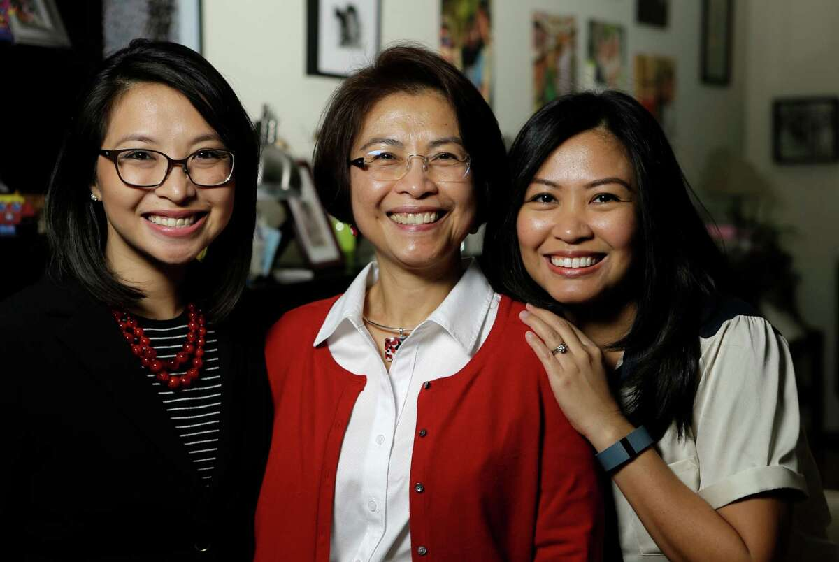 Lulu Thompson, center, left three daughters in the Philippines when she came to Houston to work as a nurse. The daughters, including Lauren Delumpa, left, and Maria Vo, later joined her.