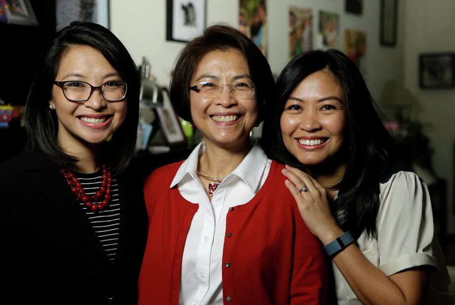 Lulu Thompson, center, left three daughters in the Philippines when she came to Houston to work as a nurse. The daughters, including Lauren Delumpa, left, and Maria Vo, later joined her. Photo: Melissa Phillip, Staff / © 2014  Houston Chronicle