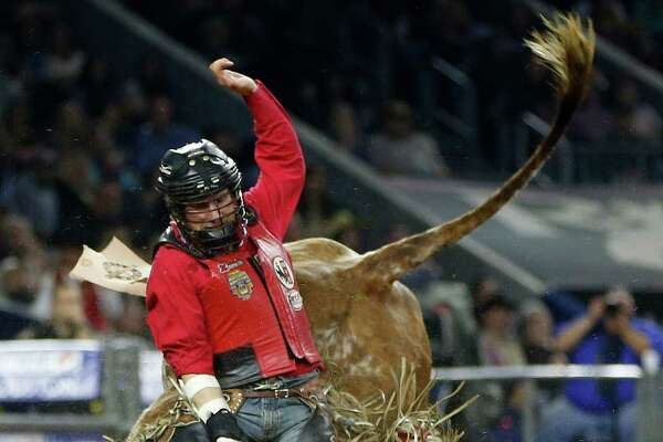 Bobby Welch rides Struck it Rich during the bull riding competion during the Houston Livestock Show and Rodeo at NRG Park, Tuesday, March 10, 2015, in Houston.