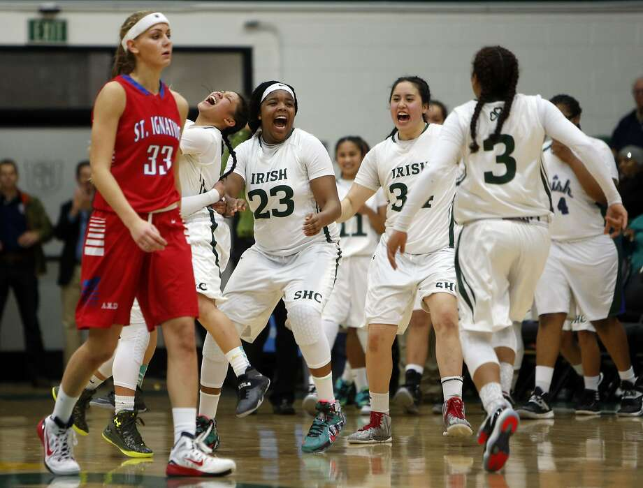 Sacred Heart Cathedral's Iimar'i Thomas (No. 23), who is only 14, and her teammates celebrate their 60-50 win over St. Ignatius at USF on Jan. 13. Photo: Scott Strazzante, The Chronicle