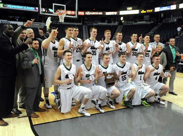 Shenendehowa poses with the championship plaque following their win over Guilderland 47-42 in the Section II Class AA Boy's Basketball Final at the Times Union Center on Tuesday March 10, 2015 in Albany, N.Y.  (Michael P. Farrell/Times Union) Photo: Michael P. Farrell / 00030949A