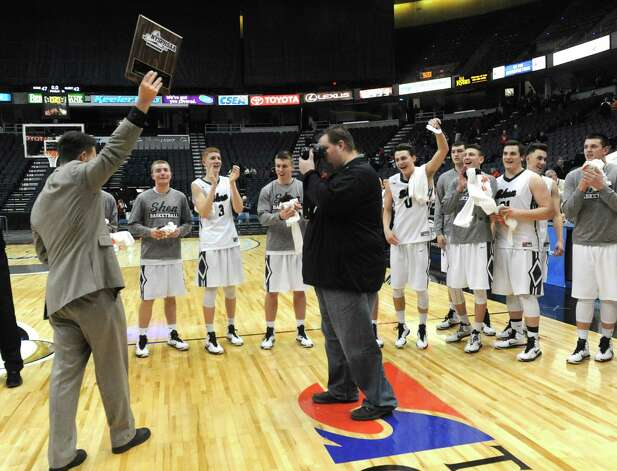 Shenendehowa head coach Tony Dzikas, left,  holds up the championship plaque after his team defeated Guilderland 47-42 in the Section II Class AA Boy's Basketball Final at the Times Union Center on Tuesday March 10, 2015 in Albany, N.Y.  (Michael P. Farrell/Times Union) Photo: Michael P. Farrell / 00030949A