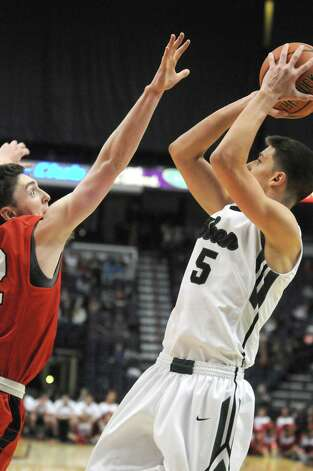 Shenendehowa's Thomas Huerter, right, puts up a shot defended by Guilderland's Andrew Platek during their Section II Class AA Boy's Basketball Final at the Times Union Center on Tuesday March 10, 2015 in Albany, N.Y.  (Michael P. Farrell/Times Union) Photo: Michael P. Farrell / 00030949A