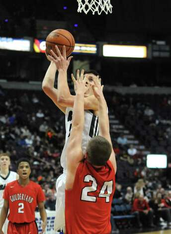 Shenendehowa's Thomas Huerter puts up a shot  during their Section II Class AA Boy's Basketball Final against Guilderland at the Times Union Center on Tuesday March 10, 2015 in Albany, N.Y.  (Michael P. Farrell/Times Union) Photo: Michael P. Farrell / 00030949A