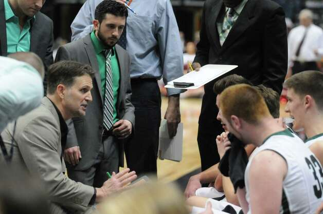 Shenendehowa head coach Tony Dzikas, left, talks with his team during their win over Guilderland 47-42 in the Section II Class AA Boy's Basketball Final at the Times Union Center on Tuesday March 10, 2015 in Albany, N.Y.  (Michael P. Farrell/Times Union) Photo: Michael P. Farrell / 00030949A