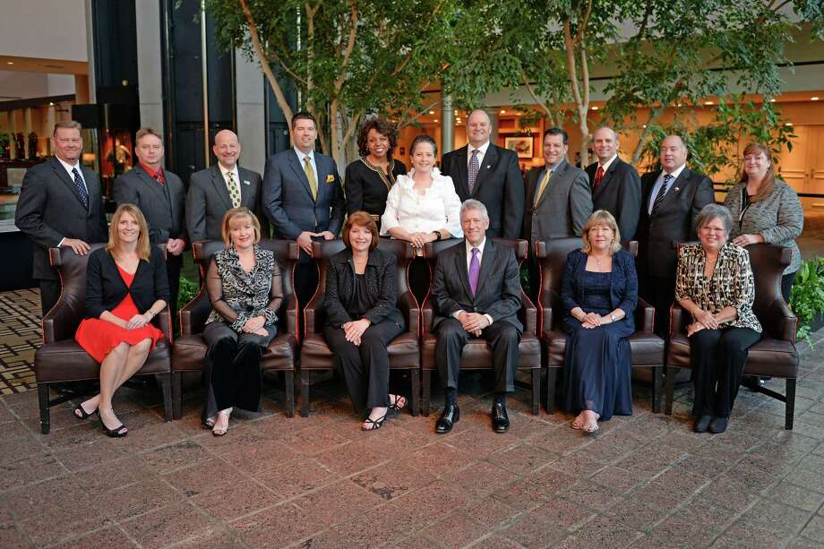 The Cy-Fair Chamber honored businesses of the year recently. Standing from left to right: Keith Vrana, Chad Gaulding, Keith Grothaus, Jason Culpepper, Dr. Audre Levy, Leslie Martone, Dr. Mark Henry, Joe Scala, Dr. Mike Castro, Mark Carruba, Jennifer Pittman Seated from left to right: Valarie Brittain, Lisa White, Beryl Ramsey, Stuart Snow, Debbie Gibson, Debbie Blackshear Photo: Courtesy