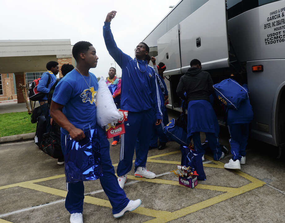 Ennis Harmon pauses for a selfie as he his teammates prepare to board the bus for San Antonio on Tuesday. Ozen High School hosted a pep rally Tuesday before seeing the Panthers basketball team off to the championships in San Antonio.  Photo taken Tuesday 3/10/15  Jake Daniels/The Enterprise Photo: Jake Daniels / ©2015 The Beaumont Enterprise/Jake Daniels