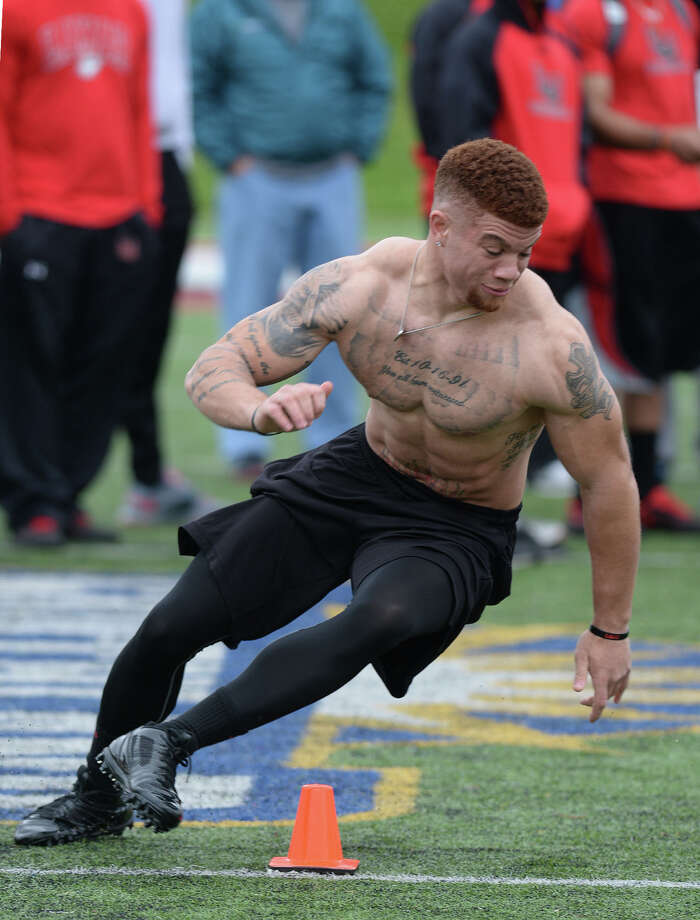 Along with other athletes, Lamar's Kevin Johnson runs timed drills for Houston and Kansas City scouts during Pro Day on the Cardinal's field Tuesday.  Photo taken Tuesday, March 10, 2015  Guiseppe Barranco/The Enterprise Photo: Guiseppe Barranco, Photo Editor