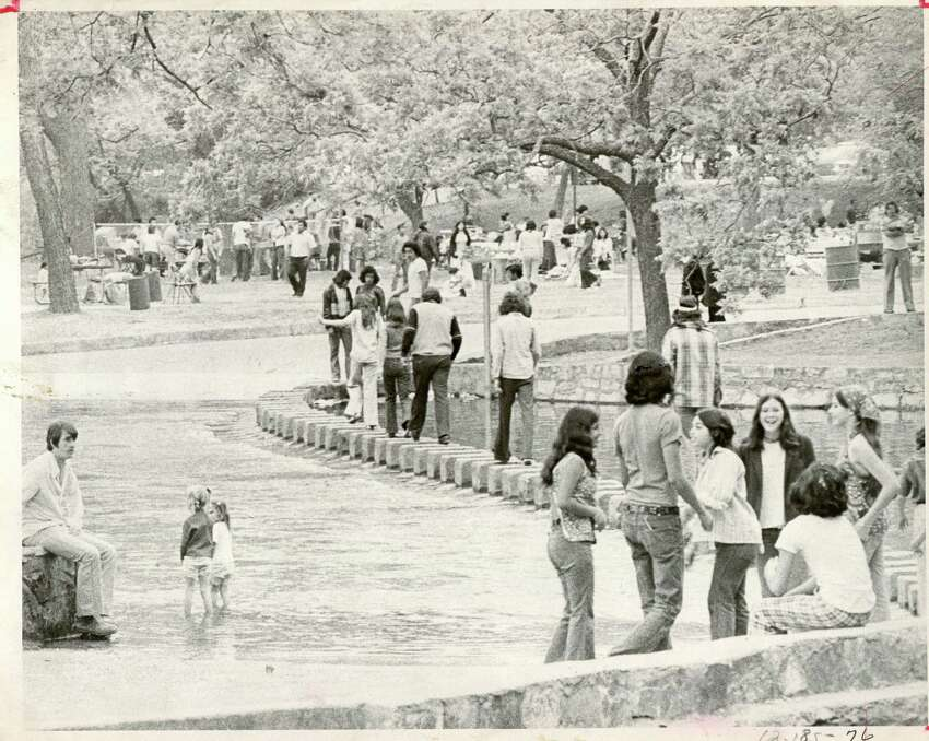 San Antonians gather in the park for a cool break in May 1975.