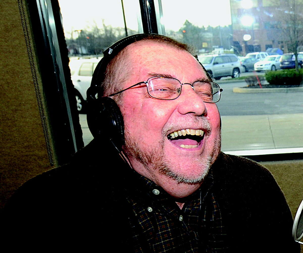 Radio personality Don Weeks enjoys a last laught as he winds up his last moments after a thirty year career at WGY in Latham December 3, 2010. (Skip Dickstein / Times Union)