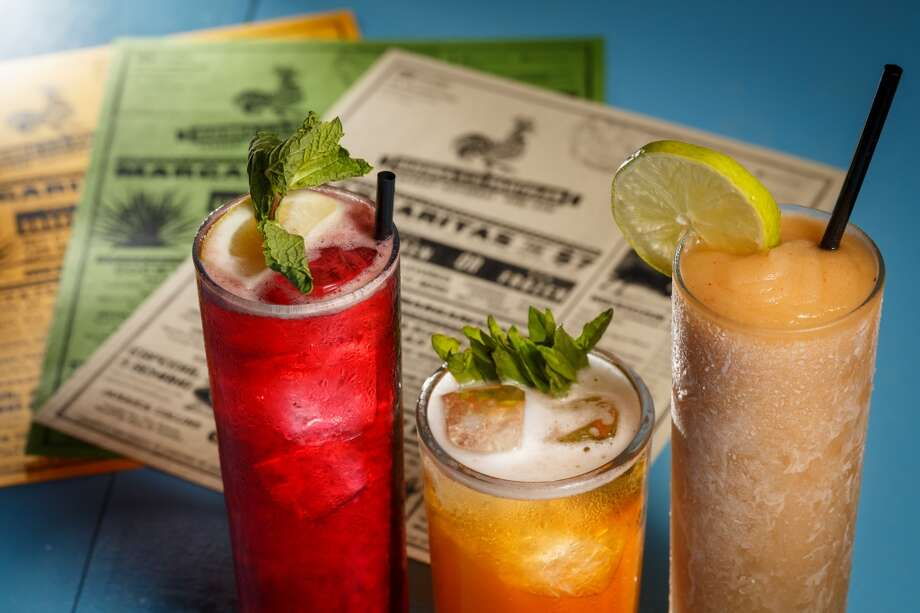 The Jamaica Collins cocktail, left to right, Mezcal and epazote tonic and Mole and Ginger Frozen Margarita, at The Pastry War. ( Michael Paulsen / Houston Chronicle ) Photo: Houston Chronicle