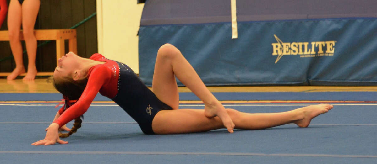 Darien Level 4 gymnast Treasa Brown strikes a dramatic pose to end her floor routine at the Connecticut YMCA Southern Leagues Championship meet.