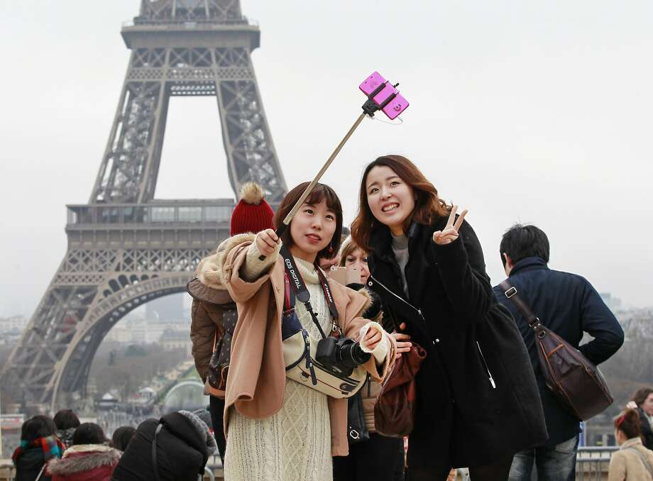 It took three researchers from the Netherlands to determine that the Eiffel Tower appears smaller when you lean to the left. Photo: Remy De La Mauviniere, Associated Press