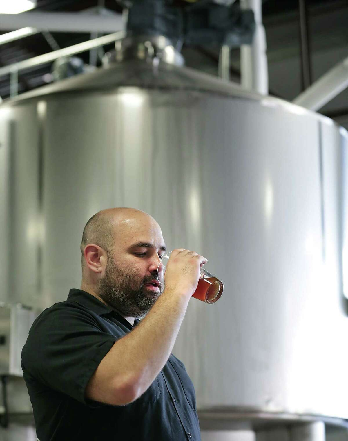 Freetail Brewing Co. founder and CEO Scott Metzger tastes a batch of wort. He says,