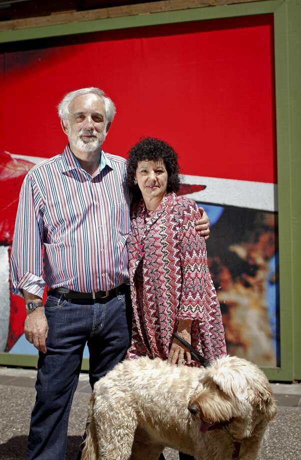 Mitch Kapor and Freada Kapor Klein and their dog, Dudley, stand in front of the Kapor Center for Social Impact in Oakland, Calif., on Wednesday, June 20, 2013. A court on Wednesday, Sept. 23, 2015, ruled that the couple could go ahead with plans to build a 10,000 square-foot hillside home in Berkeley, overriding objections by environmentalists who called for an environmental impact report. Photo: Russell Yip, The Chronicle