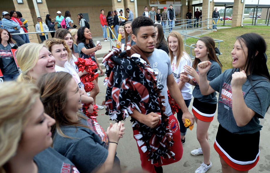 Kountze players are cheered on as they board the bus Wednesday before heading to San Antonio for the state basketball tournament. 