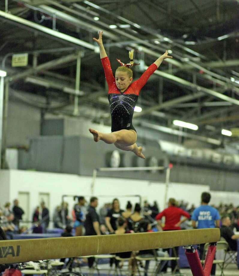 Wells Fischer, a Level 7 USAG gymnast for Arena Gymnastics in Stamford, CT and a member of the TOPS National  Team in Texas as well  the Region 6 Developmental Team in the North East hovers high above the balance beam. Photo: Contirbuted, Contributed / Darien News