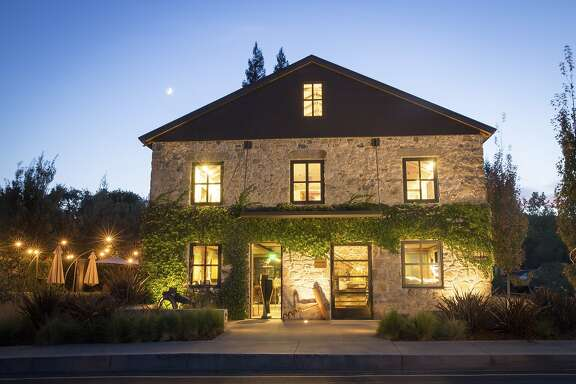 Ma(i)sonry tasting room, housed in a renovated 1904  historic stone building is used as a wine and art experience space for Blackbird and other boutique wineries under the Bespoke Collection brand.