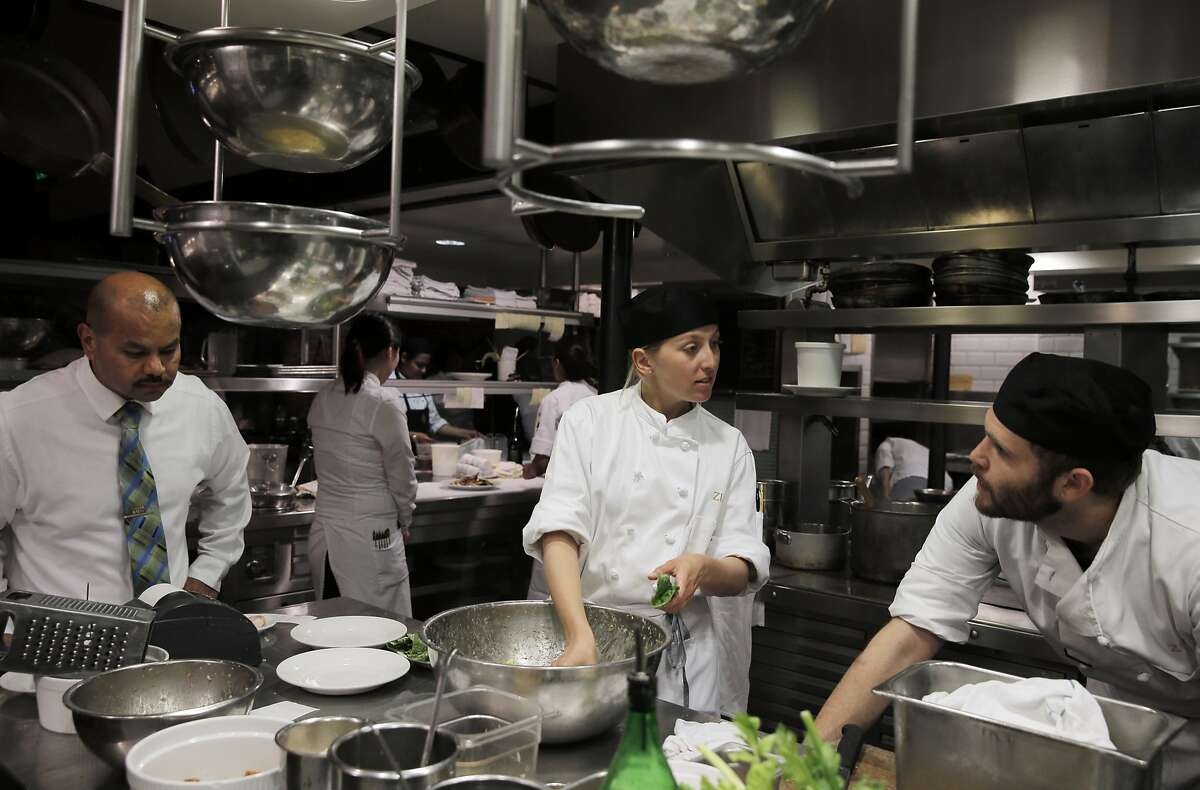 L-R, Ernesto Sanchez, Julia Clancy, and Max Newman in the kitchen preparing salads during dinner at Zuni Cafe in San Francisco, Calif., on Tuesday, March 10, 2015. Zuni is an icon in the San Francisco dining scene, and has stayed much the same for the past 35 years, including through the death of its chef/owner Judy Rogers in late 2013.