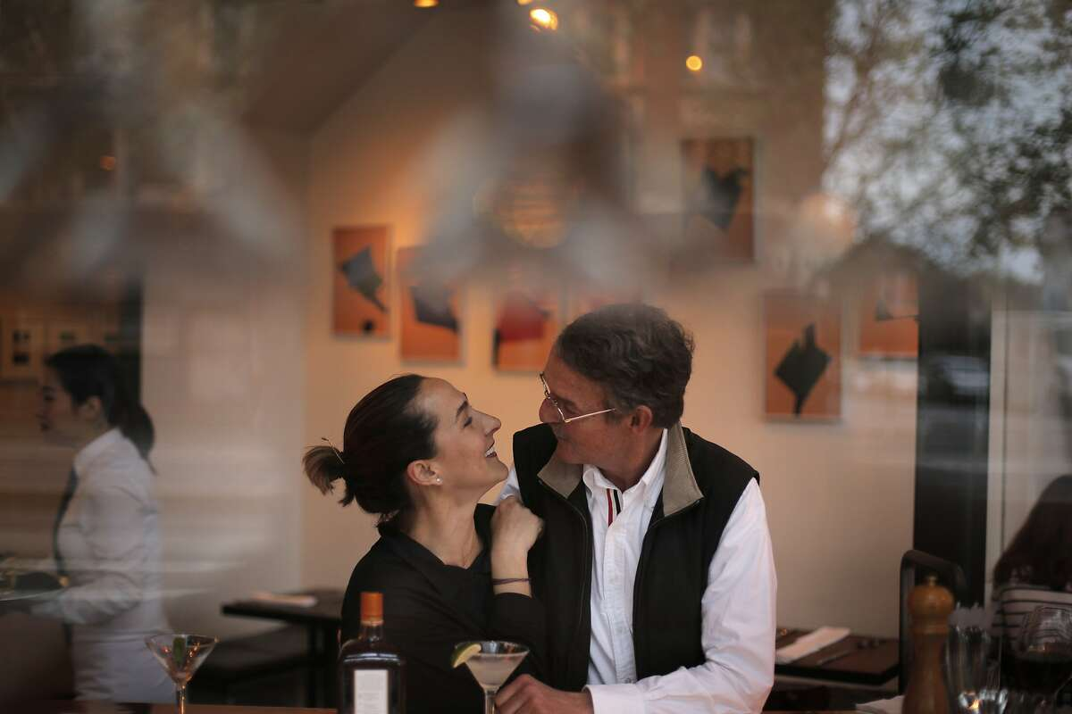 Gabriela Camara and Richard Gilbert chat at the bar during dinner at Zuni Cafe in San Francisco, Calif., on Tuesday, March 10, 2015. Zuni is an icon in the San Francisco dining scene, and has stayed much the same for the past 35 years, including through the death of its chef/owner Judy Rogers in late 2013.