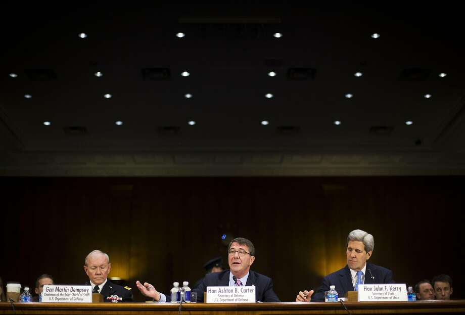 From left, Joint Chief Chairman Gen. Martin Dempsey, Defense Secretary Ash Carter, and Secretary of State John Kerry, testify on Capitol Hill in Washington, Wednesday, March 11, 2015, before the Senate Foreign Relation Committee. Three of America's top national security officials faced questions on Capitol Hill about new war powers being drafted to fight Islamic State militants, Iran's sphere of influence and hotspots across the Mideast. (AP Photo/Pablo Martinez Monsivais) Photo: Pablo Martinez Monsivais, Associated Press